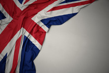 Waving National Flag Of Great Britain On A Gray Background.