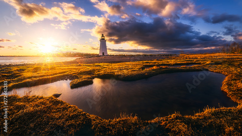 Deurstickers Chocoladebruin sunset by black rock Lighthouse