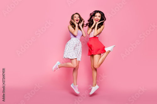 Full length body size view portrait of nice-looking smart glamorous shine attractive charming winsome lovely lovable cheerful cheery girls having fun isolated over pink pastel background - 272647458