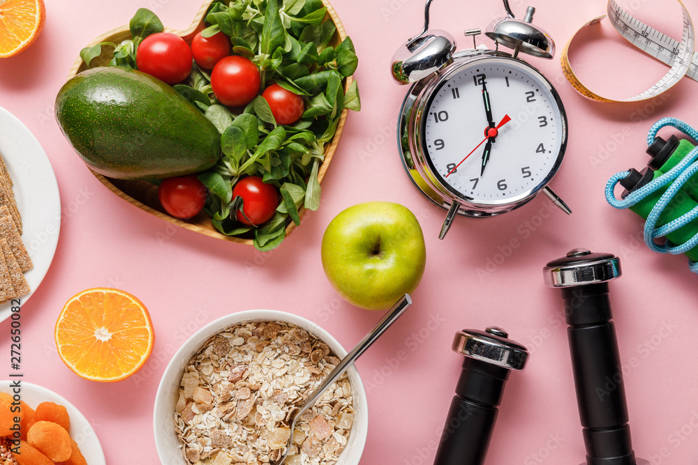 Fototapety, obrazy: top view of fresh diet food, measuring tape, sport equipment and alarm clock on pink background with copy space