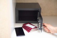 Hand Opening Safe In The Hotel