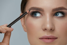 Beauty Makeup. Woman Shaping Eyebrow With Brow Pencil Closeup