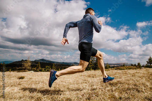 fototapeta na drzwi i meble male runner fast running on mountain trail in summer outdoor