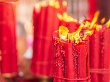 Closeup Bundle Of Big Red Candles Burning Near The Golden Tray At Longshan Temple With Copy Space.