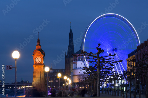Photo  Giant wheel at the Burgplatz in Dusseldorf is part of the local christmas market