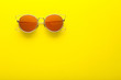 canvas print picture - Modern sunglasses on yellow background