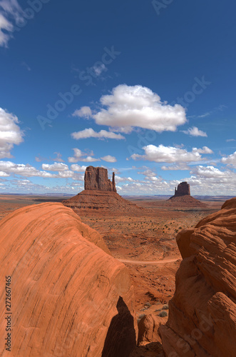 Wall Murals Magenta Monument Valley National Park with blue skies and clouds