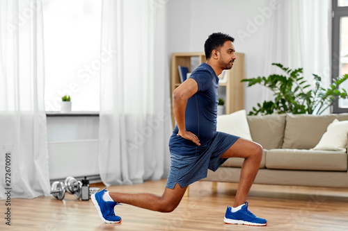 Canvas Print fitness, sport and healthy lifestyle concept - indian man exercising and doing l