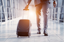 Businessman Carrying Suitcase,...