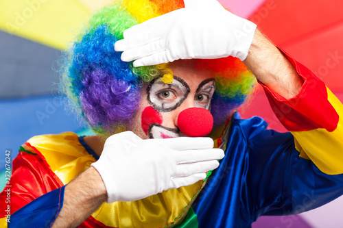 Tableau sur Toile Funny clown in a colorful background