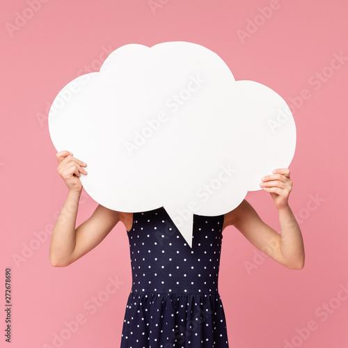 Fotografie, Obraz  Little girl hiding her face behind blank white speech bubble