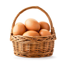Basket With Chicken Eggs Closeup On A White. Isolated.