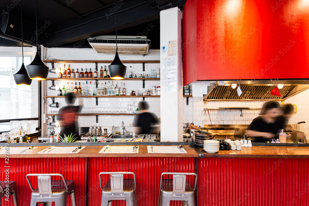 Industrial Red kitchen counter decorated in loft style including wood, white wall and red corrugated zinc sheet.