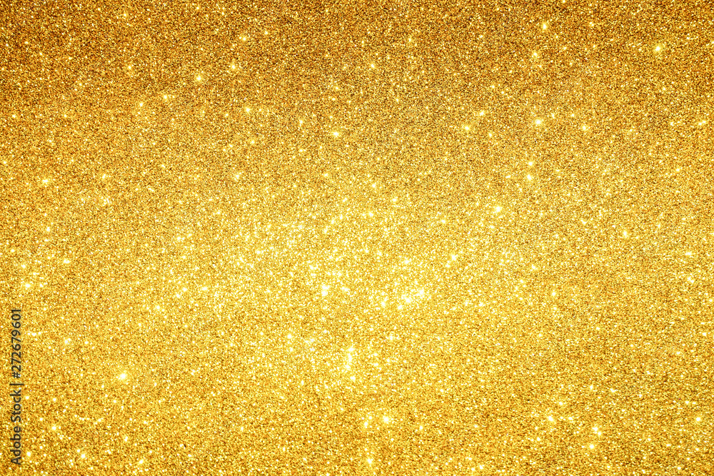 Fototapeta gold Sparkling Lights Festive background with texture. Abstract Christmas twinkled bright bokeh defocused and Falling stars. Winter Card or invitation