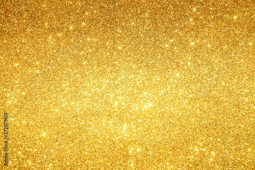gold Sparkling Lights Festive background with texture. Abstract Christmas twinkled bright bokeh defocused and Falling stars. Winter Card or invitation