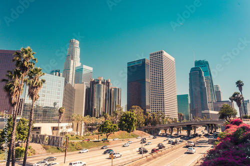 Stampa su Tela  Panoramic view on downtown of Los Angeles over route 110