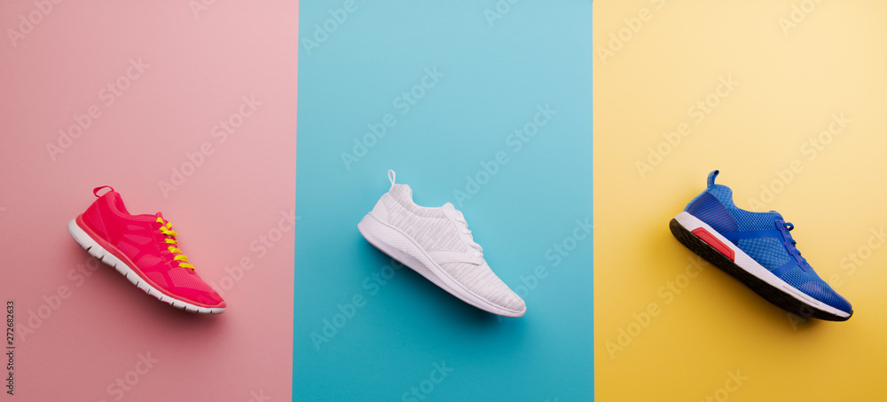 Fototapety, obrazy: A studio shot of running shoes on bright color background. Flat lay.