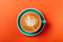 Cyan Coffee Cup Over Orange Ba...