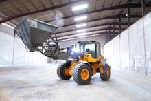 Wheel Loader Excavator. Construction Machine In The Hangar .