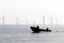 Controversial Energy Production. Wind Farm Turbines Security. Patrol Boat During Green Power Demonstration