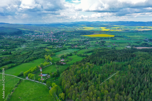Foto auf AluDibond Grun Aerial perspective view on sudety mountains with touristic city in the valley surrounded by meadows, forest and rapeseed fields