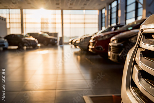 Fotografia, Obraz New cars at sunlit dealer showroom close view