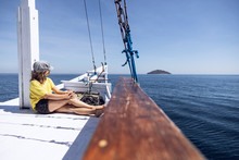 Indonesia, Komodo National Park, Girl On A Sailing Boat