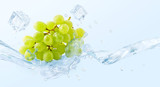 Fresh cold pure grape flavored water wave splash. Clean infused water or liquid fluid wave splash with grapes. Healthy flavored detox soft drink splash design concept with ice cubes. 3D