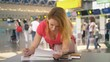 concept of transportation of an unaccompanied child. A woman with two teenage children fills out documents at the airport