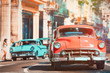 Urban scene with antique cars in Havana