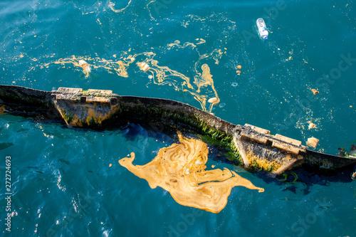 Fényképezés  Sea pollution, waste oil on the sea, pontoon sea barrier