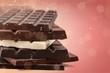 Leinwandbild Motiv Close-up broken chocolate bar isolated on white background