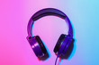 Leinwandbild Motiv Stylish headphones on color background, top view