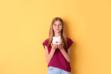 Teen Girl With Piggy Bank On C...