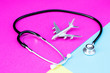 Leinwanddruck Bild - stethoscope around the plane travel insurance concept