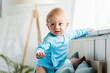 selective focus of cute toddler kid in modern bedroom