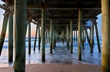 The Pier Of Old Orchard Beach, Maine At Sunrise. The Wooden Pier On The Beach Contains Many Other Tourist Businesses, Including A Variety Of Souvenir Shops.