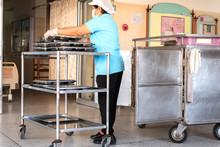 Woman Nurse Prepare Food On Cart At Hospotal For Patient.
