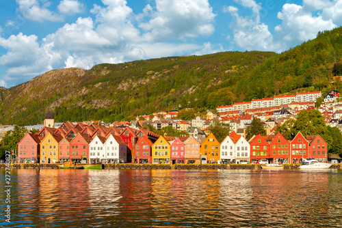 Poster Scandinavie The colorful of bergen in summer. The historical building in Bryggen district with brilliant color and beautiful blue sky with clouds in Bergen, Norway