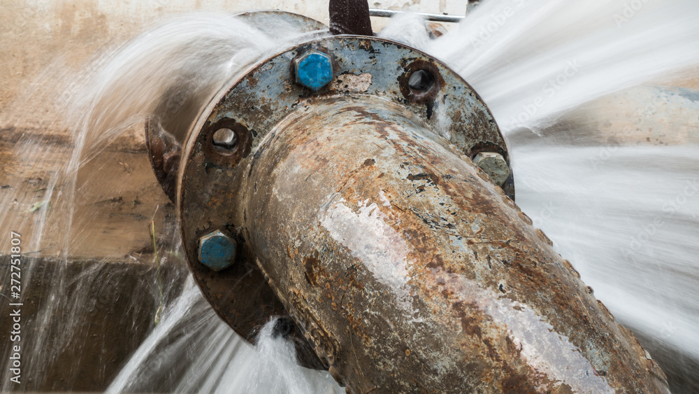 Fototapeta metal pipe with valve is leaking in water treatment plant