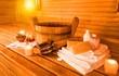 Leinwandbild Motiv Interior of sauna and sauna accessories on background