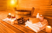 Interior Of Sauna And Sauna Accessories On Background