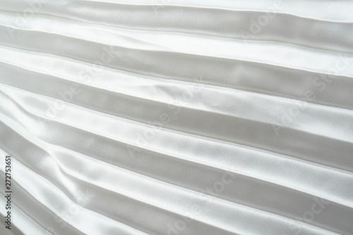 In de dag Macrofotografie White luxury satin fabric folds background. Rippled white silk fabric satin cloth gathers glamour background. Smooth elegant white silk cloth texture can use for wedding backdrops. Retro style