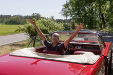 Senior Man In The Red Ford Mustang Cabriolet
