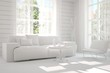 Mock up of stylish room in white color with sofa and green landscape in window. Scandinavian interior design. 3D illustration