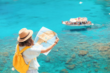 Cheerful Girl With A Map Exploring Interesting Places To Travel By Ferry Or Rented Boat Or Yacht In The Azure Gulf Of The Mediterranean Sea
