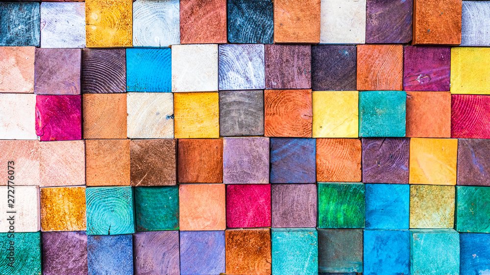 Fotografía  Wood texture block stack on the wall for background, Abstract colorful wood texture