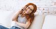 canvas print picture - portrait einer jungen schönen rothaarigen frau beim telefonieren zu hause