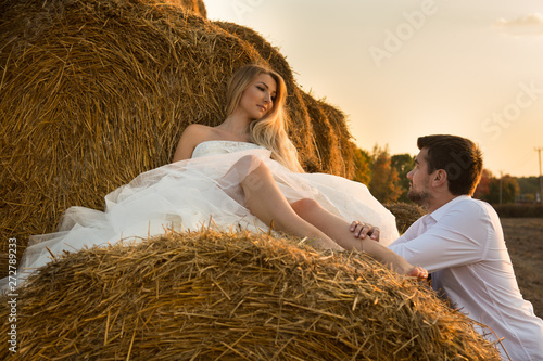Fotografie, Obraz  in the evening the bride and groom in the hayloft