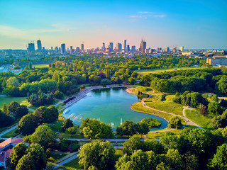 Fototapeta Warszawa A beautiful panoramic view of the sunset in a fabulous evening in June from drone at Pola Mokotowskie in Warsaw, Poland -